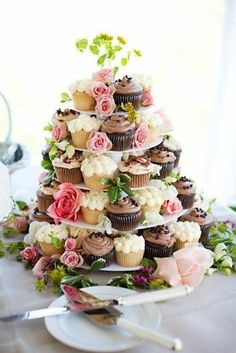 Elegant cupcake tower, decorated ,by roses + greens