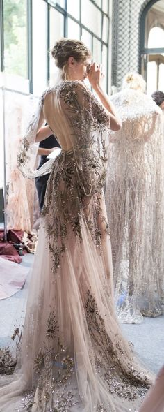 """There were fireworks at Zuhair Murad's show. They rained over dresses in bursts of embroidery, shot upward from tulle shoulder ruffles, shimmered in red crystals, and shone from the top of the bride's tiara."" Wedding dress / wedding gown / sequins inspiration for the Rasvet Jewelry Co bride."