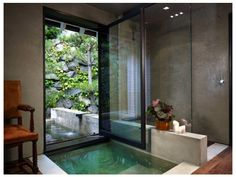 Plaster makes for a great ecofriendly shower or bath surround, as it's comprised of plentiful natural materials — lime, gypsum or cement — mixed with water. The sealers — natural waxes and/or oils — are easy on your indoor air quality and the environment.  When applied by hand, plaster has a stunning artisanal quality suited both to modern and traditional interiors. To boot, the plaster provides a durable, monolithic finish void of grout lines to clean, maintain or protect.