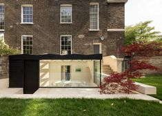 Wooden roof casts geometric shadows over London house extension Conservatory Extension, Glass Conservatory, Architects London, Movable Walls, Charred Wood, Steel Railing, Wooden Staircases, London House, Simple Interior