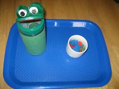 Feed the frog- Parmesan cheese container, pom poms and googly eyes. Super cute!!!!