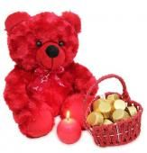 Light The Love An ideal gift for your beloved on this valentine day. Lovely red colored teddy bear of 10 inches along with 150 gms of handmade chocolates beautifully packed in a red basket. To complement the combo light this red colored ball candle and enjoy your evening. Shipping Status GiftsXper - Product Deliver by Courier in 4 to 7 Days
