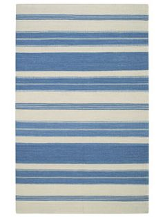 The Puhalo Stripe style is a new wool, transitional rug design from Genevieve Gorder and Capel Rugs. Puhalo Stripe rugs have a flat woven construction. The faded azul colorway is a beautiful addition to our assortment of blue area rugs