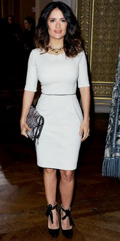 Salma Hayek Pinault sat front row at the Stella McCartney runway show in the designer's knee-length LWD and faux python clutch. A statement necklace and bowed heels completed the look.