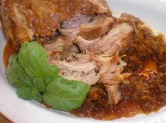 Crock Pot Pork Roast and Sauerkraut from Food.com: Throw it in the crock pot on New Year's Eve before you go out, and dinner the next day will be ready; all you have to do is fix the mashed potatoes. Slow, low cooking makes a roast that is very tender. Delicious!! I used to manage a doctor's office, and our Blue Cross rep told me that her family made this every year for New Year's.