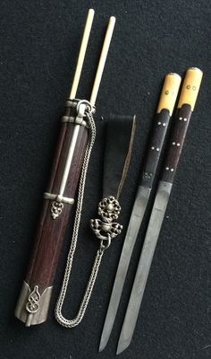 Mongolian knife set. Zitan wood scabbard, wood and bone hilt, ivory chopstick; suspended to a silver and leather belt pendant. 19th c. Private collection
