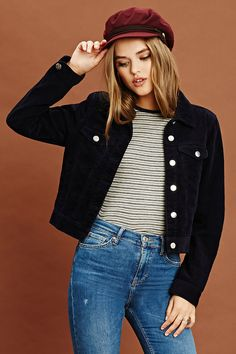 A woven corduroy jacket featuring a button front, basic collar, two front button pockets, and long sleeves with button cuffs.