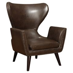 Faux leather arm chair with nailhead trim and a retro-inspired silhouette.