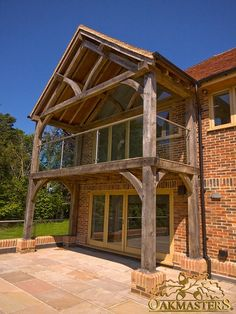 Large oak framed glazed balcony to rear of modern family house