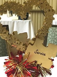 Make a centerpiece out of spray painted puzzle pieces. @ConfettiStyle shares her red and gold decorating ideas to inspire us all! http://www.rustoleum.com/product-catalog/consumer-brands/specialty/metallic-spray/
