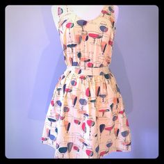 "NWT Modcloth Retro Pin Up Martini Print Dress Med. Brand New With Tags! Super cute full skirt mini dress in a vibrant Retro Vintage Martini Glass Print. Made by Beach Bash in size medium.  Sassy open back with crisscrossing straps that button at the top of the front straps. Originally $90. You're guaranteed to be the only you know that owns this awesome dress! 28"" long. I consider reasonable offers!  Beach Bash Dresses Mini"