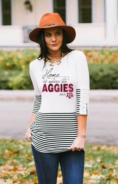 Size small. THIS TOP FEATURES STRIPES, CROCHET LACE TRIM, AND WOODEN BUTTONS. THIS FLATTERING TOP WILL STOP GAMEDAY FANS IN THEIR TRACKS. EMBELLISHMENT FEATURES GLITTER AND MATTE PRINT.-95% RAYON, 5% SPANDEX-MODEL WEARING SIZE XS