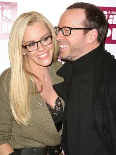 Lovebirds Jenny McCarthy and Donnie Wahlberg—both in trendy rectangular specs—were all smiles as the cuddled up to each other at a New York party.