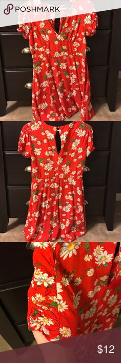 Red/orange floral mini dress This dress is super flirty and fun, but those who are bigger than a DD might have a hard time with this dress. It has crimped sleeves and a deep v, so cleavage is evident. Has a nice keyhole back and a button on top. Only worn a few times! Forever 21 Dresses Mini