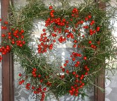 Rosemary heart wreath with wild berries