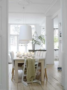 simple, clean white with light wood floors