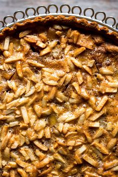 "NYT Cooking: This tart is inspired by a recipe by Jacquy Pfeiffer, from his cookbook ""The Art of French Pastry."" The apples are caramelized first with sugar and spices, then spread in the pastry, topped with an almond, egg white and sugar topping, and baked."