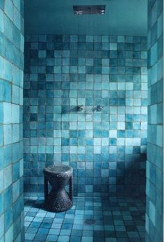 Paola Navone& Paris home. mixed shades of blue tiles.