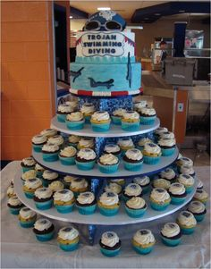 Swim Team Cake I made this cake and cupcake tower for the high school swim team end of season banquet. My son is the coach for the high...