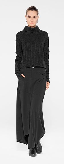 Sarah Pacini Winter 2014. All black outfit by Belgian fashion designer Sarah Pacini. Knitted assymetric sweater and long skirt