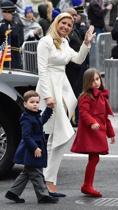 Looking very patriotic Ivanka Trump in Oscar de la Renta is joined by her daughter Arabella Kushner and son Joseph Kushner also in Oscar de la Renta, walk in the inaugural parade.