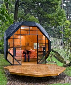 Geodesic dome houses, this itty-bitty goth golf ball of a house in the woods would make a great get away!! @ Home DIY Remodeling