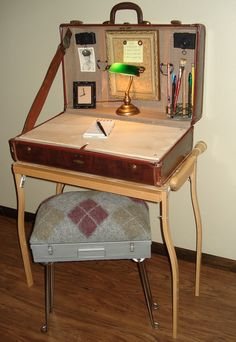 Suitcase desk with base made out of wooden crutches. Stool made out of slide case, felted sweater, and table legs...everything, even accessories, bought at Goodwill.