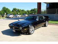 """My 1st car at sweet 16. 1971 Firebird. Black with mag wheels just like this one. Had a Holy double pumper carb in it, sweet racing cams and headers.it went """"rumpty rump when I cruised in t!"""""""
