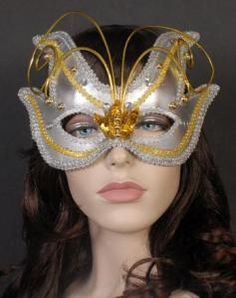 Silver masquerade mask with silver and gold