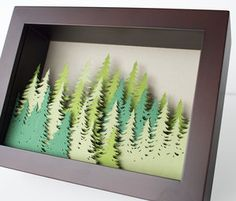 Coniferous mountain cut paper shadow box - bird mafia Paper coniferous trees hand-cut from kelly, chartreuse, and sage green paper layered in a 5 x 7 inch shadow box. Shadow Box Kunst, Shadow Box Art, 3d Paper Crafts, Arts And Crafts, Diy Crafts, Decor Crafts, Paper Wall Art, 3d Art On Paper, Paper Cut Out Art