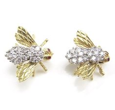 A pair of diamond, ruby and 18 karat yellow gold bee brooches