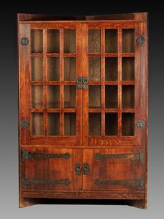 "GUSTAV STICKLEY: Rare Oak Corner Cupboard. C. 1905. Ht. 69 1/2"" W 46"" D 24"". Descended in the family of the original owners."