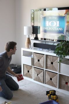 the first time i've seen one of these bookcases look GOOD as a tv stand. awesome! love it.