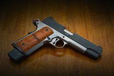Sig 1911. .45 After over a hundred years, this is still accepted as the best pistol design in history. Can't say I disagree.