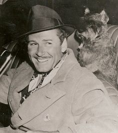 Errol Flynn with his beloved Schnauzer, Arno.