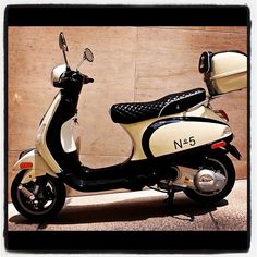 I'm miss my old Italian scooter...I'll roll in a Chanel Vespa when I'm old and glamorous, lol