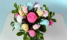 Roll onesies and washcloths into flowers to make a lovely centerpiece for a baby shower.
