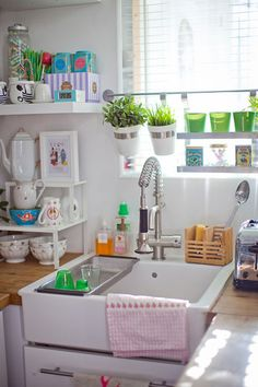 Butcher block, farmhouse sink, and cute decorative accents - a little cluttered but i love the drawers under the sink and the ikea hanging plants, etc
