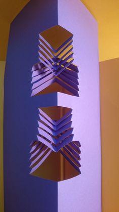 Juego con la dirección de dobleces, 1 eje de simetría (vuelta)