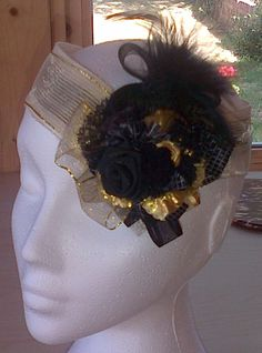 https://www.facebook.com/pages/Studio-Textiles/118505288303764?hc_location=timeline Black and Gold Headpiece