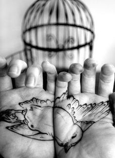 Swallow Hand Palm tattoo