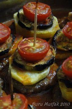 Kürdan Kebabı      Malzemeler (Küçük boy tepsi için);  2 adet patlıcan  3 - 4 adet küçük boy patates  10 adet çeri domates  1 adet...