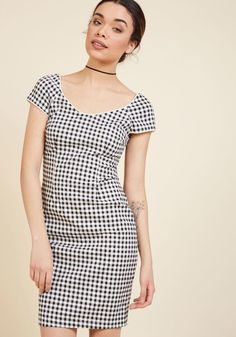 <p>You've taken your simple, sleek style and spiffed it up with a black and white pattern! Covered in a glam gingham design, this ModCloth-exclusive sheath dress uses its bateau neckline, cap sleeves, tailored fit, and white piping to perfect your retro radiance.</p>