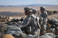 Col. Joseph Wawro and Command Sgt. Maj. Wylie Hutchison, the commander and senior noncommissioned officer of the 4th Infantry Brigade Combat Team (Dragon Brigade), 1st Infantry Division, visit with Soldiers of Company A., 1st Battalion, 28th Infantry Regiment, 4IBCT , during a training mission at the National Training Center, Fort Irwin, Calif., Feb. 14. The Dragon Brigade is preparing for their deployment to Afghanistan later this year. (U.S. Army photo by Staff Sgt. Tiffany Monnett, 4IBCT…