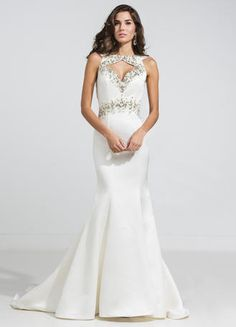This beaded evening dress is a show stopper with a keyhole bodice and open back. Rhinestone and tonal beading adorns the cut outs and adds a flattering belt. The full-length mermaid silhouette is complete with a train
