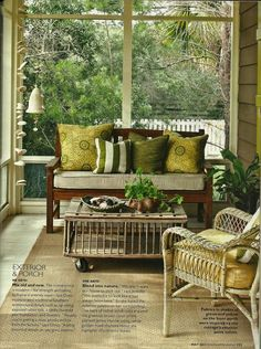 Simple screen porch on a hillside with a view of the treetops.
