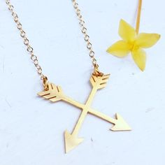 Crossed arrows pendant in 24k gold plated stainless steel. Strung on gold filled chain with gold filled components. 20 inches long. Pendant hangs an additional inch. Click here to sign up for the Call
