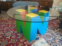 Power up your living room decorum by giving it a geeky touch with the Nintendo 64 coffee table base. Ideal for any old school gamer, this custom base is an exact replica of the logo for the beloved Nintendo 64 console. Nerd Room, Nerd Cave, Gamer Room, Man Cave, Nerd Geek, Geek Decor, Cafe Geek, Sala Nerd, Deco Gamer