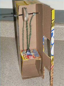 Model elevator  Things You'll Need  Cardboard cereal box  Scissors   Corrugated cardboard  Wire coat hanger  Baby food jar  Hot glue gun  Twine (or dental floss)  Aluminum foil, decorative paper and craft glue (optional)