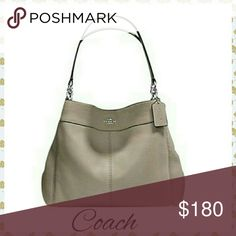 """NWT COACH LEXY SHOULDER BAG PEBBLE ●NWT COACH LEXY SHOULDER BAG ●PEBBLE COLOR ●Bag size: 13""""L × 11""""H x 5""""W ●New with tags, never used ●3 large comparments with a zipper in the middle  ●Will fit an iPad ●One compartment with a zipper pocket and two open pockets perfect for cell phones Coach Bags Shoulder Bags"""